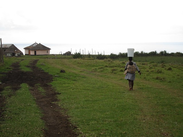 Woman Carrying Water in Xhosa Village