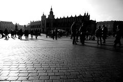 krakow #11 (reinetor) Tags: street travel light shadow people bw lens eos prime europe f14 wide poland krakow transit 5d 24mm strolling  ef24 historiccentre  ef24f14