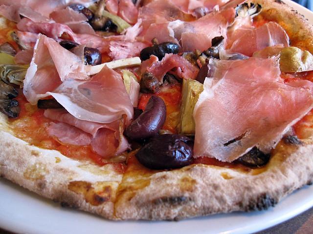 Capriciossa pizza with Prosciutto, artichoke hearts, olives and ham