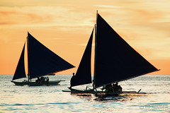 Boracay Sunset (Ed Kruger) Tags: ocean travel blue sunset red sea sky people orange sun holiday seascape reflection water sunshine silhouette yellow clouds evening boat fishing fisherman october asia southeastasia waves ship niceshot asians fishermen yacht horizon philippines wave sunny vessel boating boracay fishingboat allrightsreserved admiralty caticlan banka yachting skyphoto cargoship 2011 travelasia peopleofasia asiancities shipphoto earthasia edkruger asiancountries photoofocean cultureofasia photosofasia photosofthesky