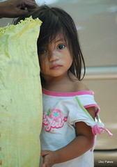 shy little girl (ubo_pakes) Tags: poverty street portrait girl face yellow big eyes nikon asia pretty little philippines poor shy cebu curious pinay filipina lovely cebucity hiding visayas ctu d60 ubo beeautiful pakes flickraward doubleniceshot tripleniceshot mygearandme mygearandmepremium mygearandmebronze mygearandmesilver mygearandmegold