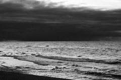 dark sky, reflecting sea (john grzinich) Tags: sea 50mm baltic nikkor nida lithuania ais gh2
