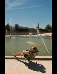Baking (Stuart-Lee) Tags: shadow man paris france fountain candid tuileries sunbathing iledeparis