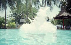 Pool (SimonMuskitta) Tags: bali film water pool analog 35mm canon jump asia malaysia splash maluku maleisie canonftb