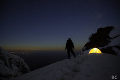 Dawn Approaches (Ben Canales) Tags: longexposure camping winter orange snow night oregon sunrise dark stars dawn star tent glacier backpacking cascades mthood mountaineering pacificnorthwest glowing lit starry cascademountains reachthesummit landscapeastrophotography bencanales