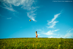 Rhythm of LIFE (Darshan Chakma) Tags: life nyc newyorkcity blue sky cloud green girl field ball happy fly pretty play action timessquare dhaka playful bangladesh chasama rhythmoflife artistwanted collectme