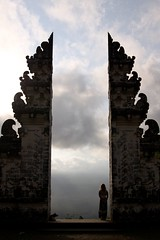 Waiting for the Clouds to Break (DrTH80) Tags: shadow bali woman dog sunlight mountain silhouette clouds indonesia temple volcano gate profile gunung volcanic pura clouded shadowed agung lempuyang