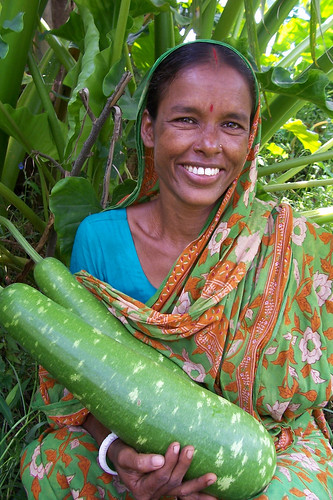 Woman and the vegetables that she has grown, Bangladesh. Photo by WorldFish, 2004