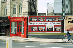 Going for a Pint as Good as Guinness? (Non Paratus) Tags: uk england london film beer ad billboard guinness advertisement holborn scanned canonae1 stout