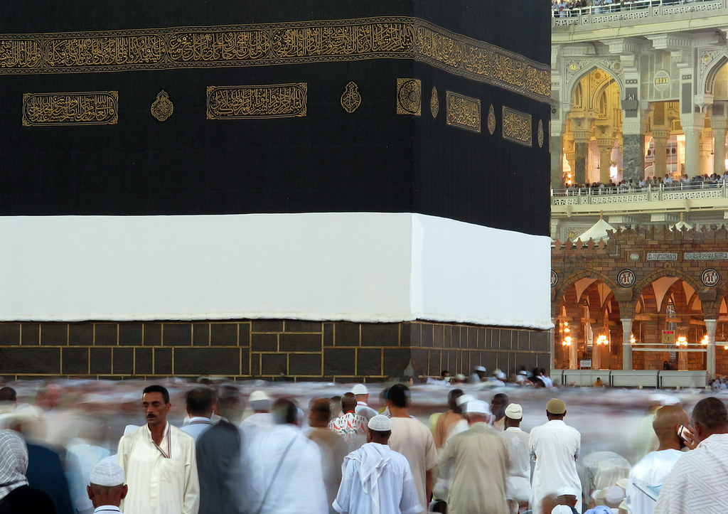Muslim pilgrims move around the Kaaba, the black cube, inside the Grand Mosque, in Mecca