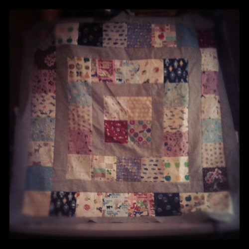 Baby quilt made by using Made by Rae tutorial and Japanese Import swap charms. Better photo when sun is out.  Sashing is Essex Linen Putty. by stayathomelibrarian