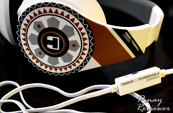 Timbre headphones in gold-grey and charcoal black on white