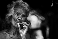 Nek Koloi (Carlos Nizam) Tags: bw woman house alone smoke malaysia tribes aboriginal cigarettes discovery pahang customs orangasli