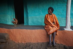 Paroja woman outside her house, Orissa, India. (ingetje tadros) Tags: india village tribes tradition clan ethnic society orissa realpeople australiangeographic tribalcommunity parojatribe ingetjetadros internationalloupeawards tribesinorissa villagesinorissa