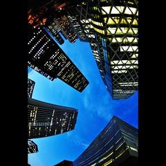 Skyscrapers (hidesax) Tags: blue sunset sky urban cloud building japan architecture skyscraper tokyo nikon shinjuku exposure raw dusk single nishishinjuku d90 nikond90 cocoontower hidesax tokinaatx107dxfisheye1017mmf3545if