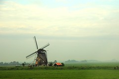 Amsterdam,  Netherlands (faungg) Tags: travel holland netherlands windmill field amsterdam scenery snapshot      throughtrainwindow 0054