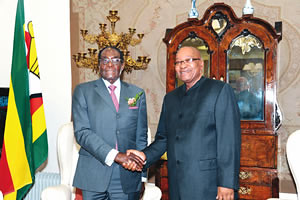 Presidents Robert Mugabe of Zimbabwe and Jacob Zuma of South Africa. The neighboring southern African states are members of the Southern African Development Community (SADC). by Pan-African News Wire File Photos