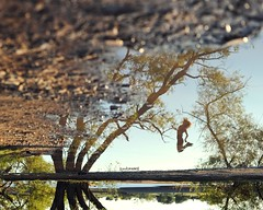 Perception (David Parks - davidparksphotography.com) Tags: city lake david reflection oklahoma girl mirror jump nikon parks okc edmond hefner d700