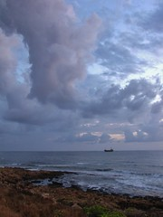 largeness ii. (Michiko.Fujii) Tags: sea water clouds evening coast cyprus shipwreck dwarfed paphos coastlines pafos lostatsea largeness auborddelamer