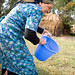 Galima Muhametarimovna cleans a bucket before milking one of her four cows in her yard