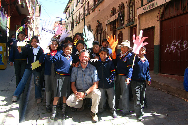 School children welcoming tourists in La Paz, Bolivia