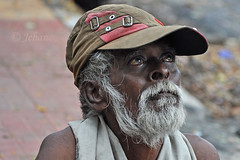 Man at the Milk Booth. (Jehane*) Tags: people india man nikon cap chennai jehane 2011 nikond5000 jehanephotography