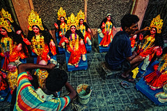 Artists giving final touch to goddess Laxmi Idols : the day before Laxmi Puja (Sukanta Maikap Photography) Tags: street india streetphotography kolkata calcutta westbengal laxmipuja handpulledrickshaw lifeonstreet clayidol tokina1116f28 potuapara laxmiidol goddesslaxmipuja canon450dtokinaatxprosd1116mmf28ifdx