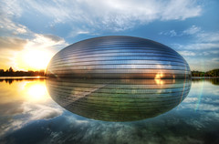 The PhotoWalk Egg in China (Stuck in Customs) Tags: china city travel fiction sunset sky sun reflection set architecture modern clouds digital photography design blog high asia republic postmodern dynamic stuck walk metallic space egg beijing science structure september east photoblog software dome processing photowalk scifi metropolis imaging  prc operahouse northern titanium range brilliant hdr tutorial trey peking travelblog customs theegg municipality watery bijng 2011 paulandreu ratcliff ncpa northernchina nationalgrandtheatre ellipsoid hdrtutorial stuckincustoms  treyratcliff photographyblog peoplesrepublicofchina stuckincustomscom  nationalcentrefortheperformingarts nikond3x gujidjyun