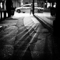 Rays (Brînzei) Tags: bucurești bw nightwatch pavement reflection shadow squareformat streetlighting vignette bokeh windows ★ canoneos400d black canonef50mmf18ii explored blackandwhite