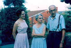 Unidentified Pittsburghians c. 1965 (captainpandapants) Tags: family trees woman house man brick home glasses clothing women couple pittsburgh pennsylvania daughter posed husband places pa elderly wife 1960s shrub shrubs shrubbery buildingtypes