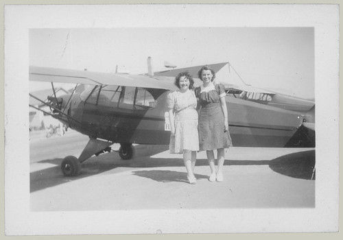 Two women and an airplane