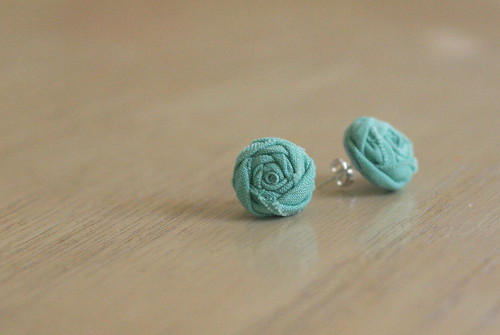 rosette earrings.
