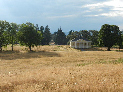 Fort Lawton historical gymnasium, holy ground, yellow grassy field, trees, Discovery Park, Seattle, Washington, USA by Wonderlane