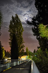 Moonlighting (Mike G. K.) Tags: park bridge trees moon night clouds cyprus rail blending akropolis nicosia lefkosia 2exp noonlight mikegk:gettyimages=submitted