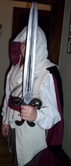 hayden hiding behind the sword (groovyholly) Tags: halloween halloweencostume hayden assassin ezio homemadecostume assassinscreed yesimadeit halloween2011 madefromrecycledclothing eziocostume