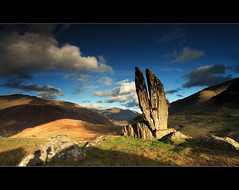 Split Stones Glenlyon (angus clyne) Tags: camera old autumn light sunset shadow red cloud sun mountain art fall wet rock stone standing forest canon dark