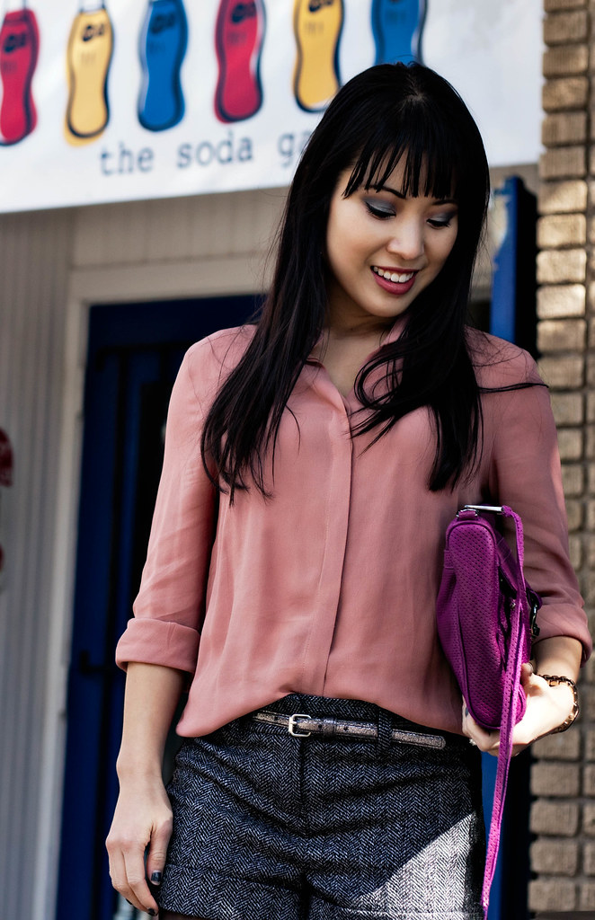 forever 21 pink sheer chiffon button-up shirt, express lace panel tweed shorts, dkny black tights, jessica simpson livia ankle boots, charlotte russe metallic silver skinny belt, michael kors rose gold small runway watch mk5430, rebecca minkoff mac clutch in magenta