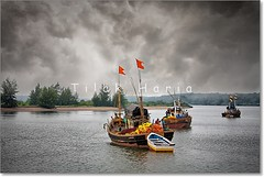 Calm Before the Storm (Tilak Haria) Tags: sea clouds boat fishermen maharashtra backwaters konkan boatmen pratibimbsangli konkanmaharashtra