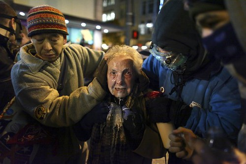 84-year-old woman pepper sprayed by the Seattle police during a demonstration on November 15, 2011. Authorities have attacked Occupy Wall Street encampments and demonstrations throughout the United States. by Pan-African News Wire File Photos