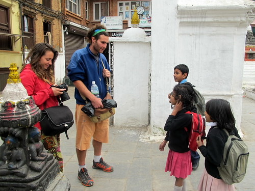 Tourists talking with Nepali children at Kathesimbu