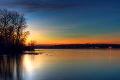 Sunset on Chiemsee (Luigi R. Viggiano) Tags: trees sunset lake water silhouette reflections citylights chiemsee