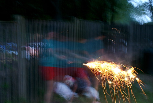 Running with sparklers.