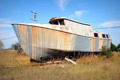 Tugboat ashore in Ontonagan Michigan. (Cragin Spring) Tags: old mi rural boat rust midwest decay michigan tugboat upnorth upperpeninsula lakesuperior smalltown decaying ashore ontonagonmichigan ontonagan ontonagonmi