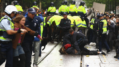 Australian riot police remove protesters occupying areas in Melbourne. The anti-capitalist movement has spread throughout the world. by Pan-African News Wire File Photos