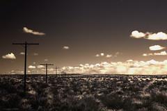 {untitled} [Explored] (skippys1229) Tags: arizona blackandwhite bw clouds canon landscape nationalpark perspective painteddesert canonrebel telephonepoles grassland petrifiedforest 2011 bwconversion arizonatrip rebelt1i t1i canonrebelt1i
