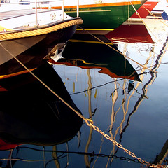 boats at Ouchy (overthemoon) Tags: triangles port marina reflections square boats schweiz switzerland chains colorful suisse harbour angles multicoloured lausanne colourful ropes multicolored svizzera ouchy moorings vaud prows romandie imagepoetry imageposie