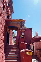 Inside the Ganden Monastery (docpap) Tags: travel blue sky sun colors wall stair peace blu religion tibet monastery cielo scala meditation mura spiritual lhasa rosso ganden rayoflight redmonks