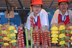 Don't i look bored? (andrewyeoh76) Tags: china people food fruits beijing vendor streetfood exoticfood donghuamen