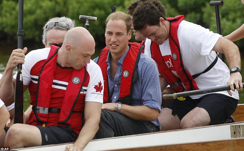 Prince William rules the waves as he beats Duchess of Cambridge in dragon boat race but despite the drizzly day Kate Middleton looks simply 29