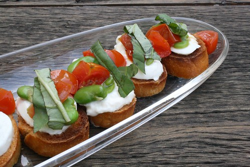 Fava Bean and Roasted Cherry Tomato Crostini with Burrata and Basil